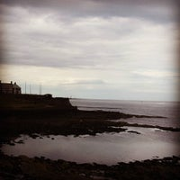 Photo taken at Cullercoats Beach by Richard L. on 8/7/2015