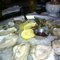 Photo taken at Coast Seafood & Raw Bar by Shutthefucup S. on 5/28/2013