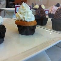 Photo taken at Sweet Surrender Cupcake & Cookie Cafe by Bryan M. on 2/16/2013