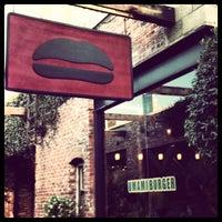 Photo taken at Umami Burger by Jia D. on 5/25/2013