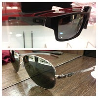 Photo taken at Sunglass Hut by Jia D. on 1/19/2013