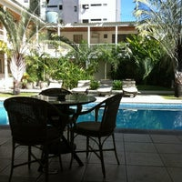 Photo taken at Hotel Aconchego by Mayra R. on 11/30/2012
