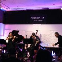 Photo taken at Somethin' Jazz Club by Stella K. on 12/24/2012