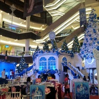 Photo taken at Paradigm Mall by anthony b. on 12/26/2012