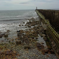 Photo taken at Cullercoats Beach by K K. on 7/2/2015