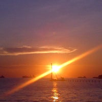 Photo taken at Ancol Beach by Elyzabeth Sitompul on 1/14/2013