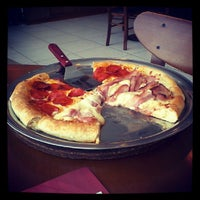 Photo taken at Pizza Hut by Cristiane B. on 12/2/2012