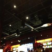 Photo taken at BJ's Restaurant and Brewhouse by Mallory E. on 12/16/2012