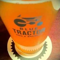 Photo taken at Blue Tractor BBQ & Brewery by Ryan L. on 5/25/2013