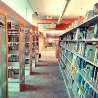 Photo taken at Cameron Village Regional Library by Christian A. on 4/4/2013