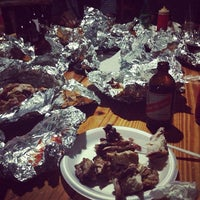 Photo taken at Scotchies Jerk Centre by Alexander H. on 4/12/2013
