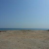 Photo taken at AsSeifa Beach by Ulan on 10/15/2013