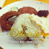 Photo taken at Ponggol Nasi Lemak Centre by Esther L. on 3/1/2013