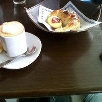 Photo taken at Fratello Cafe by Juan V. on 11/1/2012