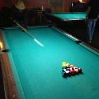 Photo taken at Twain's Brewpub & Billiards by Julian S. on 12/12/2012