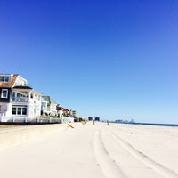 Photo taken at 12th Street Beach by Michele Marie B. on 10/26/2014