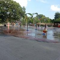 Photo taken at Greenwood St Sprinkler Park by Aleska V. on 7/21/2013