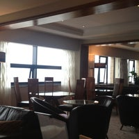 Photo taken at Executive Lounge by Damian G. on 5/19/2013