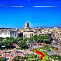 Photo taken at Plaça de Catalunya by Лина М. on 7/6/2013