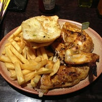 Photo taken at Nando's by Emanuel A. on 4/5/2013