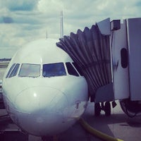 Photo taken at Gate F10 by Chomp T. on 7/23/2013