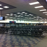 Photo taken at Terminal 2 by Alex T. on 9/28/2012