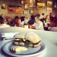 Photo taken at Awaken Cafe by Jennifer L. on 7/9/2013