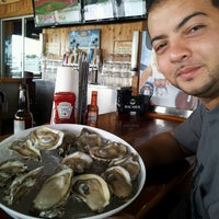 Photo taken at Hooters by Miriam G. on 7/13/2013