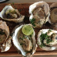 Photo taken at La Docena Oyster Bar & Grill by Juan pablo M. on 2/20/2013