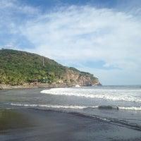 Photo taken at Playa El Zonte by Oscar D. on 12/15/2013