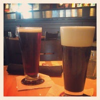Photo taken at BJ's Restaurant and Brewhouse by Christopher D. on 7/9/2012