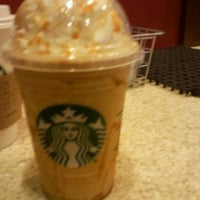 Photo taken at Starbucks by Charlotte M. on 7/16/2012