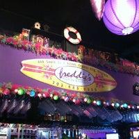 Photo taken at Freddie's Beach Bar by Karen M. on 3/30/2012