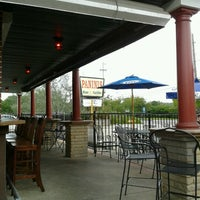 Photo taken at Panini's Bar and Grill by Andrea H. on 8/19/2012
