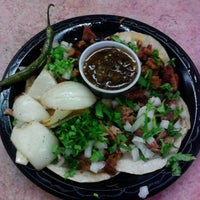 Photo taken at Guedo's Taco Shop by Ricardo J. on 9/20/2011