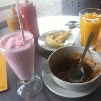Photo taken at American Burger by Natalia P. on 4/29/2012