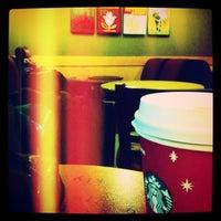 Photo taken at Starbucks by İrem T. on 2/2/2012