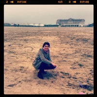 Photo taken at Plage de Deauville by Romain P. on 3/2/2012