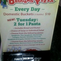 Photo taken at Beggars Pizza by Theresa H. on 9/17/2012
