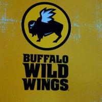 Photo taken at Buffalo Wild Wings by NewCarMark™ on 3/10/2013