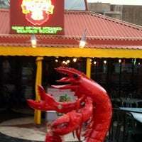 Photo taken at Poppy's Crazy Lobster Bar & Grill by Estevan P. on 12/19/2012
