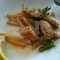Photo taken at On The Table Restaurant by suzy r. on 5/30/2012