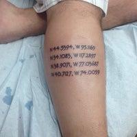 Photo taken at Champion Tattoo by Aaron on 9/20/2014