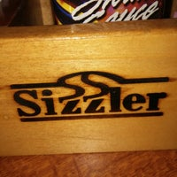 Photo taken at Sizzler by Carmencita S. on 7/6/2014