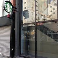 Photo taken at Starbucks Coffee 神田駅前店 by こば on 7/10/2013