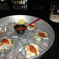 Photo taken at Finn McCool's Fish House and Tavern by Jason C. on 3/16/2013