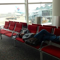 Photo taken at Gate 21 by Bert A. on 2/28/2013