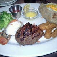 Photo taken at Black Angus Steakhouse by Cara R. on 12/29/2012