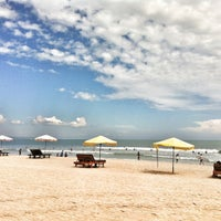 Photo taken at Pantai Kuta (Kuta Beach) by baba w. on 6/16/2013
