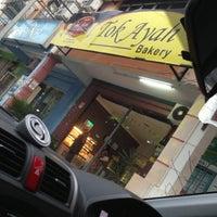 Photo taken at Tok Ayah Bakery (Roti Naik) by Tasha W. on 11/26/2012
